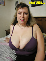 Big titted mature slut showing her wet cooch